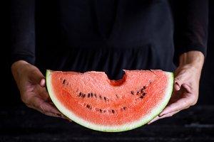 sweet watermelon in woman hand
