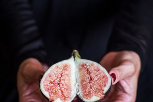 sweet fig in woman hand