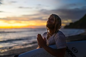 surfer praying for waves