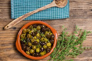 Bowl of olives with thyme