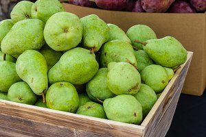 Green Bartlett pears at the market