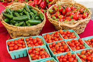 Baskets of peppers and tomatoes