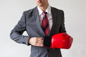 Business man taking off their boxing gloves as he gives up on tasks