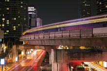 Bangkok's famous business landmark cityscape in busy light trails at night