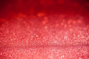Red glitter surface with red light bokeh - It can be used for background for special occasions promotion campaign or product display