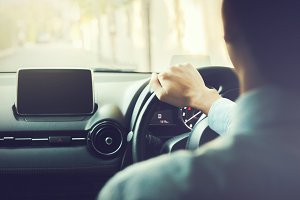 Close-up of Young man driving on the road - in vintage tone