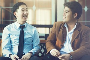 Two Asian Business Men Discussing while Sitting (Vintage Tone)