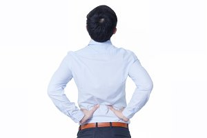 Young Asian businessman suffering back pain - office syndrome concept