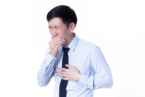 Asian businessman suffering from a bad cough