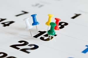 Pushpins on calendar, Busy and overworking days. Important date or meeting appointment reminder concept.