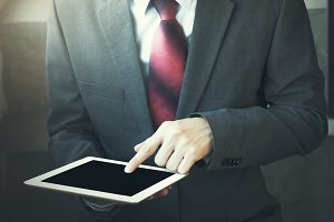 Close-up of Businessman using tablet - in vintage tone