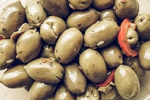 Green olives vegetables background vintage desaturated