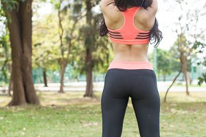 Back View of Fitness Woman Stretching out in the park