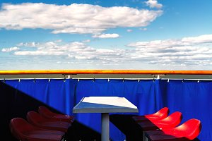 Red chairs on the ferry