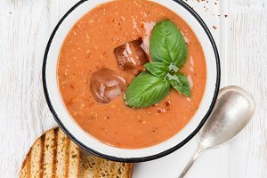 Cold gazpacho tomato soup in bowl