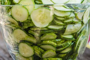 Sliced pickles in glass bowl