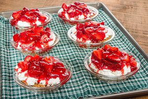 Strawberry pies with whipped cream