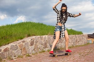 Woman is doing some thick with skate