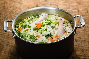 Chicken soup in a cook pot