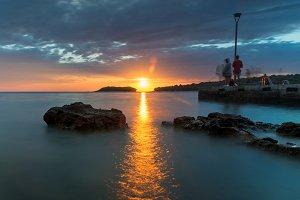 Fishing at sunset at sea