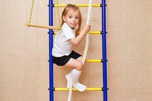 Little girl climbs stairs