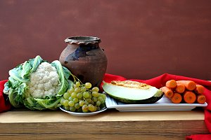 vegetables and clay pot