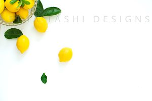 Yellow Lemons Styled Stock Photo