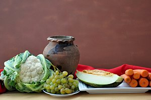 vegetables and ancient clay pot