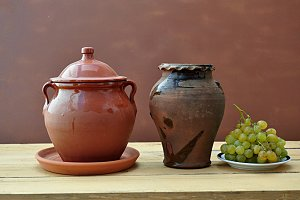 clay pots and grapes