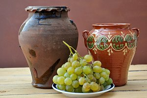 grapes and clay pots