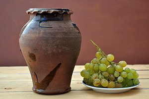 grapes and ancient clay pot