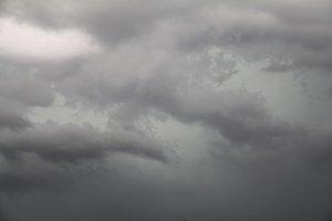 dark wispy storm clouds
