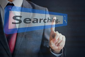 Businessman tapping and searching on search bar