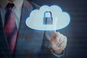 Businessman pressing Cloud computing protection conceptual icon on virtual screen