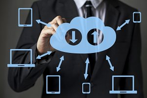 Front faced businessman is writing cloud computing diagram concept