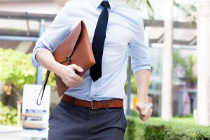 Young Business Asian exhausted man running late for work