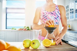 Fit healthy woman making fresh juice