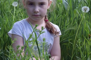 The little girl in the grass