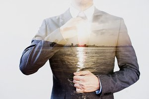 Double Exposure of businessman in offshore sunset sea background