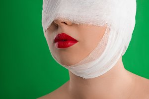 The woman with a bandage on her head