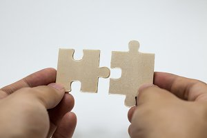 Human hands connecting pieces of jigsaw - Business team, solving problem together concept