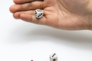 Human hand ready to roll the dice on white isolated background - Try luck, Take Risk or Business concept (Focus on hands)