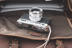 Leather Bag and Film Camera