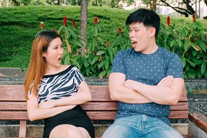 Asian couple having disgreement - love and relationship conflict concept