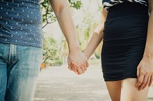Couple in love holding hands with each other in the park