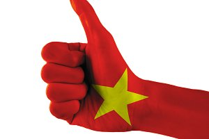 Vietnam flag painted hand showing thumbs up sign on isolated white background with clipping path