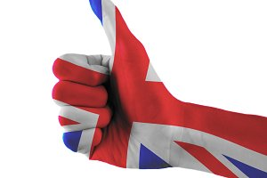 United Kingdom (Great Britain) flag painted hand showing thumbs up sign on isolated white background with clipping path