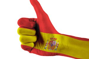 Spain flag painted hand showing thumbs up sign on isolated white background with clipping path