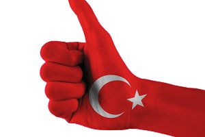 Turkey flag painted hand showing thumbs up sign on isolated white background with clipping path