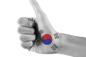 South Korean flag painted hand showing thumbs up sign on isolated white background with clipping path